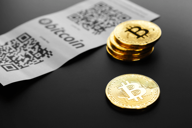 Bitcoin golden coins and paper receipt