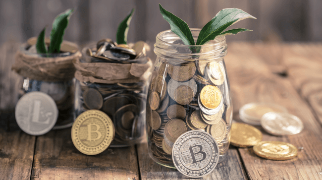 Jars with coins and crypto coins