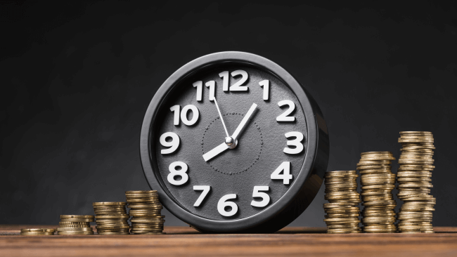 Alarm clock near stashed coins illustration